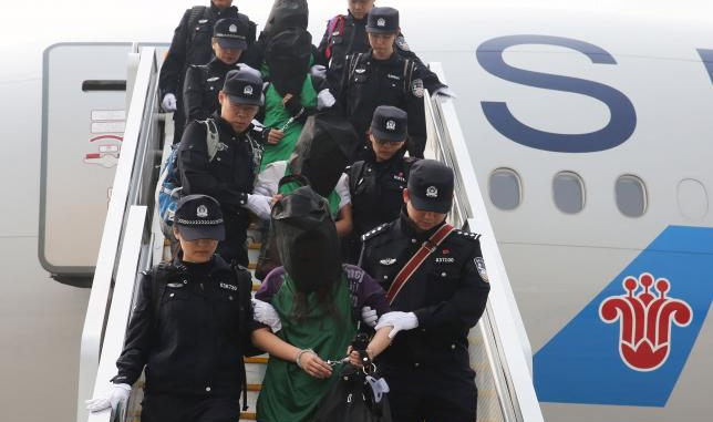 China tells Taiwan it will try telecoms fraud suspects