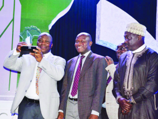 Managing Director, Premium Pension Limited, Wilson Ideva, holding the award won on Driving Inclusive Coverage of Pension Scheme and Excellence in Corporate Governance in Pension System by the company at the just-concluded Africa Pension Awards/World Pension Summit in Abuja. With him are the Company Secretary, Mr. Nasiru Idris Shall; Chief Marketing Officer, Mr. Kabir Tijjan; and a Board Member, Mr. Ibrahim Babayo.
