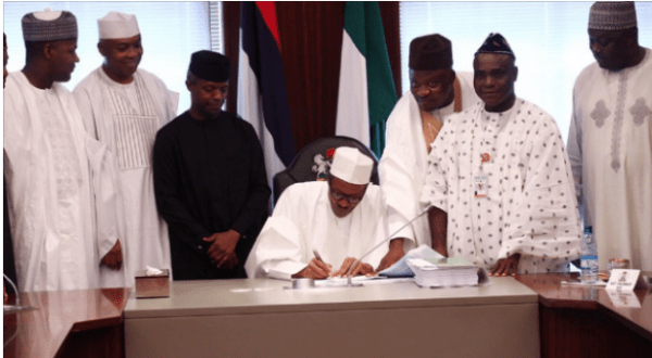 Buhari Finally sign 2016 budget Into Law