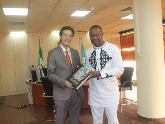 L-R Amb. Leopoldo R. Verdesoto presenting a pictorial book to Hon. Minister of State for Petroleum Dr. Emmanuel Ibe Kachikwu after the meeting.