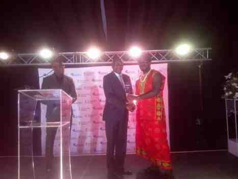 Odimegwu Onwumere receiving the award from the Director-CEO of Continental Reinsurance PLC Dr Femi Oyetunji