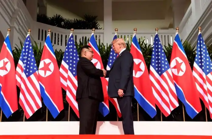 BREAKING: Trump, Kim share historic handshake as new era begins for N/Korea